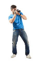 Standing man taking photo with dslr isolated