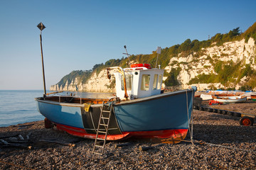 Fishing boat on the beach in Beer, Devon, UK