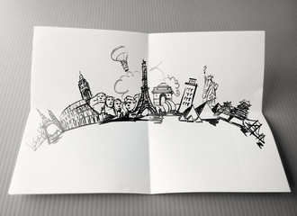 hand drawn traveling around the world on paper background as vin
