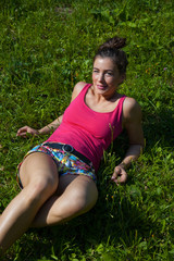 Woman relaxing on grass