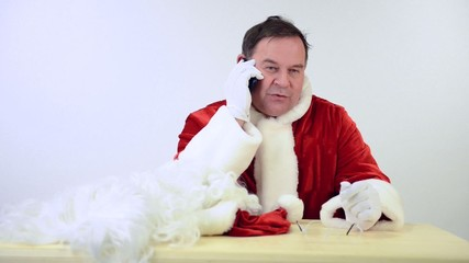Santa Claus talking by the phone. on a white background