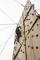 man climbing a climbing wall