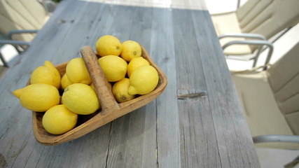 Lemons in a basket on a wooden table