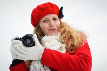 Girl with camera on mountain, beautiful and happy