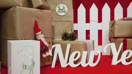 "Christmas composition with gifts on the text: ""New Year"""