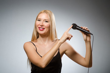 Woman singing in karaoke club