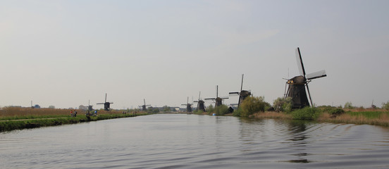 Dutch landscape with windmills.