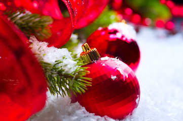 Christmas red baubles on snow background