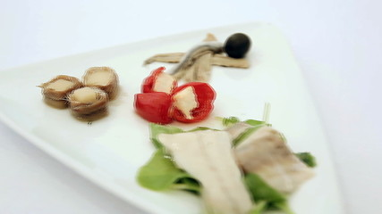 Appetizer of marinated fish with cheese and pepper. dolly shot