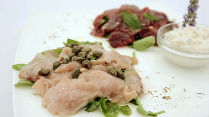 Appetizer of fresh raw tuna and sword fish. Dolly shot