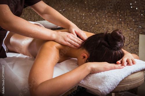 Leinwandbild Motiv Masseur doing massage on woman body in the spa salon.
