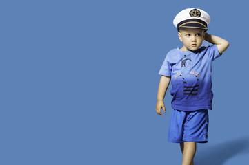 Fashionable little blond boy wearing sailor hat