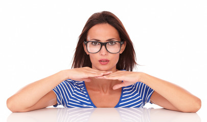 Charming female with spectacles looking at you