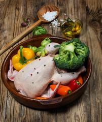 Preparing roast chicken with vegetables