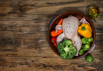 chicken with vegetables and olive oil top view