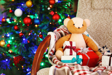 Christmas tree with teddy bear and gift boxes