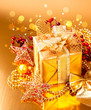 Decorated Christmas golden gift box with baubles