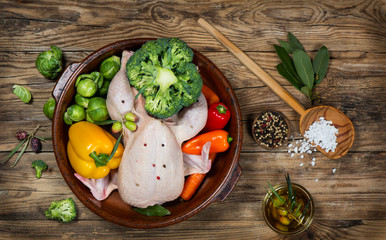 Preparing roast chicken with vegetables, top view