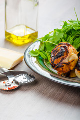 Pizza snails, minipizza with salad and parmagio