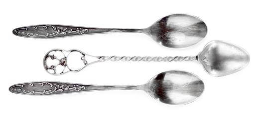 Three teaspoons isolated on white