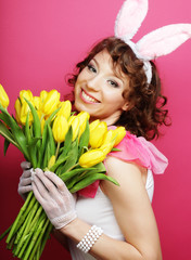 Woman with Bunny Ears holding yellow tulips
