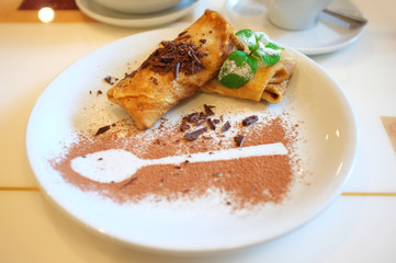 Tasty pancakes on plate in cafe