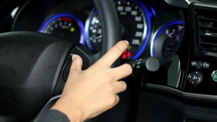 Business woman push button in modern car.