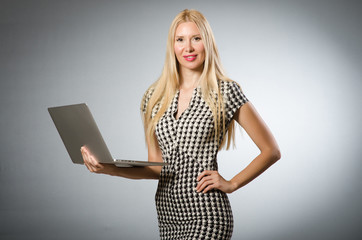 Business woman holding silver laptop