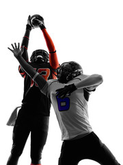 two american football players pass action silhouette
