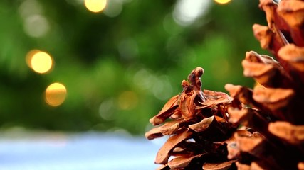 Pine cone ornaments and christmas tree beautiful background
