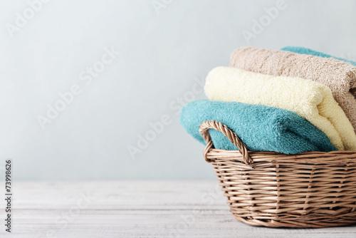 Bath towels in wicker basket - 73998626