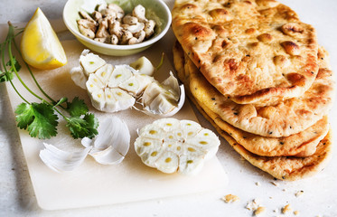 Pile of flat bread and spices on a table