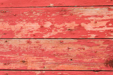 Red painted wooden siding boards