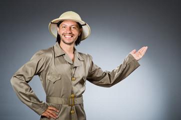Funny safari hunter against background