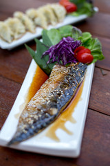 close up tail of grill Saba Fish -Selective focus point