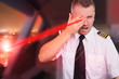 Landing plane and pilot blinded by laser beam