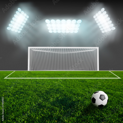 Papiers peints Stade de football Soccer ball on green stadium arena