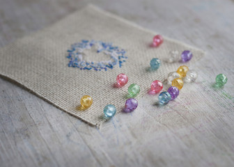 colored glass beads and fabric with embroidery