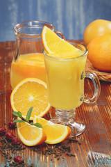 Orange juice and fresh oranges