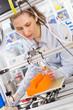 Leinwanddruck Bild - girl student makes the item on the 3D printer