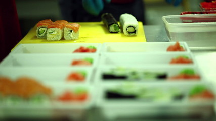 Japanese cuisine cafe. Cooking sushi and rolls
