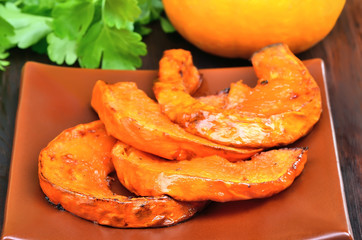Baked pieces of pumpkin on plate