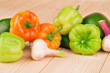 Various fresh vegetables on wood.