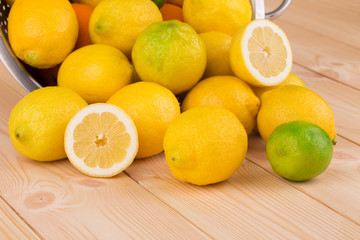 Citrus fruits on wooden background close up.