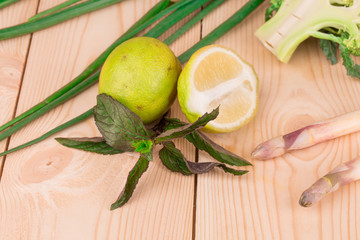 Lime half on wooden background.