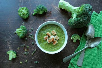 Tasty broccoli cream soup in a bowl with croutons