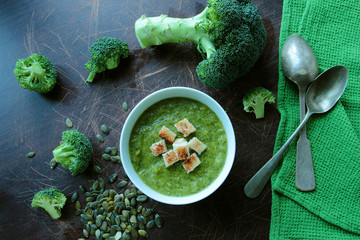 Broccoli cream soup in a bowl with croutons