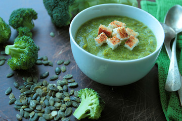Bowl with broccoli soup with croutons
