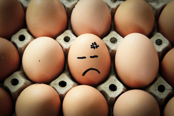 Egg with drawn face emotions.