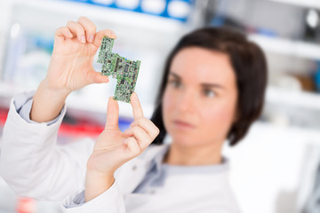 girl student studying electronic device with a microprocessor